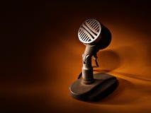 Retro microphone. Studio shot of retro microphone on dark background Stock Photos
