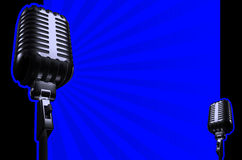 Retro microphone. Aon blue background Stock Photography