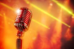Retro microphone. Against colourful background Royalty Free Stock Photo