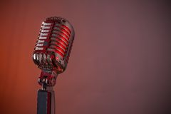 Retro microphone. Against colourful background stock photography
