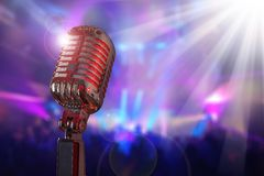 Retro microphone. Against colourful background royalty free stock image