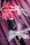 Retro microphone against colourful background Royalty Free Stock Photography