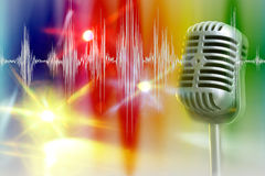 Retro microphone with audio wave. Under spotlight Stock Image