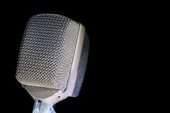 Retro Microphone on Black. Retro audio microphone on black background stock image