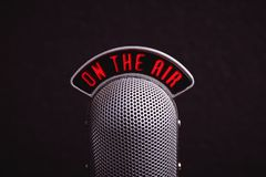Retro microphone close-up. Retro microphone on a black background, close-up royalty free stock image
