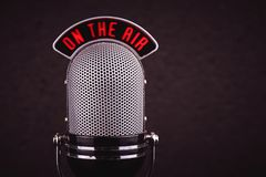 Retro microphone close-up. Retro microphone on a black background, close-up stock images