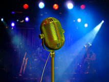 Retro microphone with blue reflectors. Retro microphone with colorful reflectors on the background Royalty Free Stock Photo
