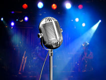 Retro microphone with blue reflectors. Retro microphone with colorful reflectors on the background Stock Photos