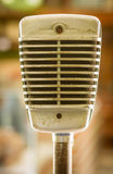 Retro microphone. On blur background Royalty Free Stock Images