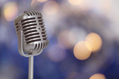 Retro Microphone with bokeh background Stock Photos
