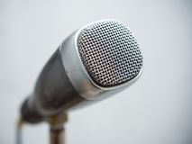 Retro Microphone Close-Up. Close-up of a professional retro microphone from sixties on a stand royalty free stock images