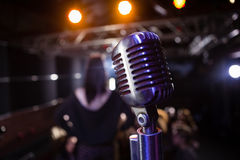 Retro microphone at a concert. Close-up of retro microphone at a concert royalty free stock photos