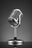 Retro microphone on grey. Macro photo of retro microphone on grey Stock Image