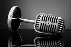 Retro microphone on grey. Photo of retro microphone on grey Stock Photos