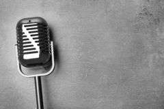 Retro microphone on grey background, top view. With space for text stock photography