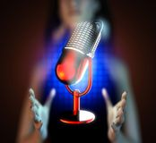 Retro microphone on hologram Royalty Free Stock Photography