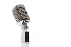 Retro microphone isolated against white Royalty Free Stock Photos