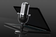 Retro Microphone with laptop Royalty Free Stock Image