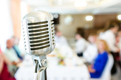 Retro microphone on light background Royalty Free Stock Photography