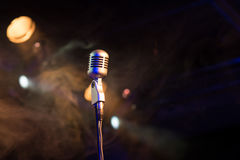 Retro microphone mic, professional equipment with light and smoke Royalty Free Stock Photos
