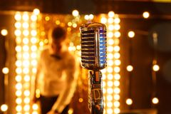 Microphone Retro microphone A microphone on stage. Retro microphone A microphone on stage A pub. Bar Restaurant stock photo