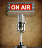 Retro microphone in the old studio. With on air sign Royalty Free Stock Photo