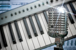 Retro microphone. Retro microphone over piano and recording software background stock photo