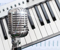 Retro microphone over piano. stock images
