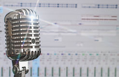 Retro microphone over recording software. Royalty Free Stock Photo
