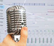 Retro microphone over recording software background. Royalty Free Stock Photo