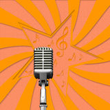Retro microphone on paper background Stock Photography