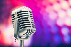 Retro microphone. On purple background Stock Photography