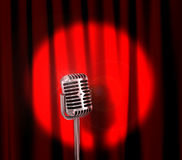 Retro microphone. And red curtain stock photo