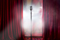 Retro microphone and red curtain Royalty Free Stock Photo
