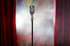 Retro microphone and red curtain Stock Images