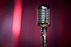 Retro microphone and red curtain Stock Photos