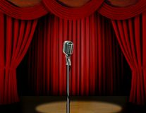 Retro microphone and red curtain. On stage with spotlight Royalty Free Stock Images