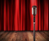 Retro microphone with red curtain Royalty Free Stock Image