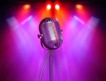 Retro microphone with reflectors. On the background Royalty Free Stock Photo