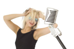 Retro microphone and rock singer with sunglasses Royalty Free Stock Images