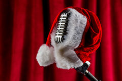 Retro microphone with santa hat Royalty Free Stock Photos