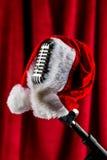 Retro microphone with santa hat Stock Photo