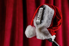 Retro microphone with santa hat Royalty Free Stock Images