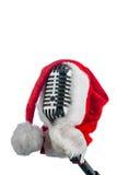 Retro microphone with santa hat Stock Photos