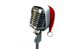 Retro microphone with santa hat Royalty Free Stock Image