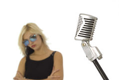 Retro microphone and singer with sun glasses Royalty Free Stock Photo