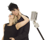 Retro microphone with singers in background Stock Image