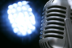 Retro microphone with spotlight Royalty Free Stock Image