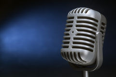 Retro microphone with spotlight Stock Photo