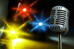 Retro microphone with spotlight Royalty Free Stock Photo